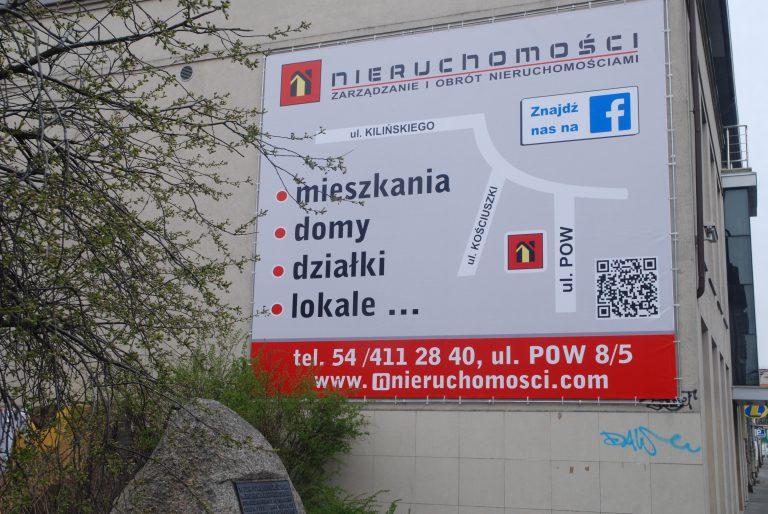 Reklama na budynkach Włocławek Szyld tablica reklamowa