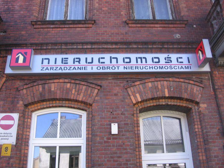 Szyld nieruchomości Włocławek - Reklama na budynku